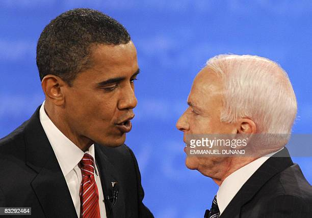 US Democratic presidential candidate Barack Obama and Republican John McCain greet each other at the end of their third and final presidential debate...