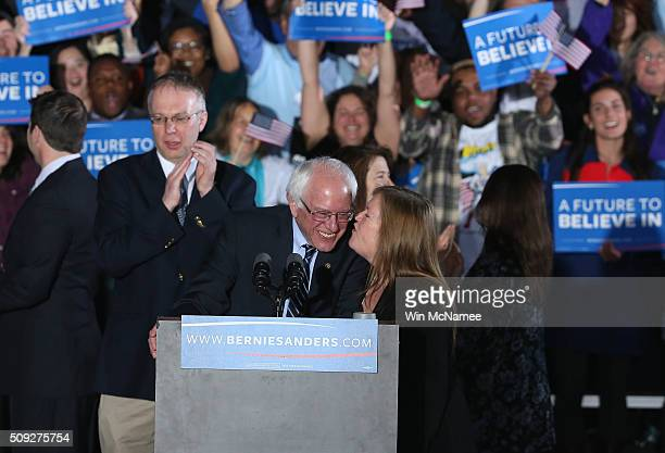 Democratic presidential candidate Bernie Sanders and his wife Jane O'Meara kiss while greeting supporters after winning the New Hampshire Democratic...