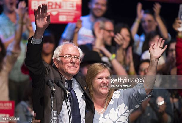 Democratic presidential candidate Bernie Sanders and his wife Jane Sanders wave at a rally March 23 2016 at the Wiltern Theater in Los Angeles...