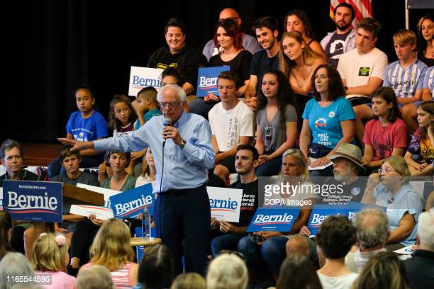 Democratic presidential candidate Bernie Sanders discusses health care costs at an ice cream social in Raymond New Hampshire hosted by Ben Cohen and...