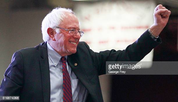 Democratic presidential candidate Bernie Sanders gives a fist pump after his speech at West High School at a campaign rally on March 21 2016 in Salt...