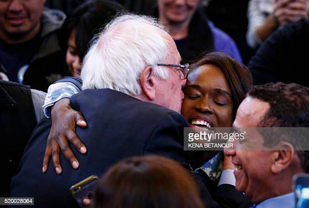Democratic presidential candidate Bernie Sanders kisses a supporter during a Rally at the Bronx Community College in New York on April 9 2016...