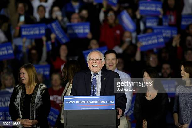 Democratic presidential candidate Bernie Sanders laughs as he speaks during his Caucus night event at the at the Holiday Inn February 1 2016 in Des...