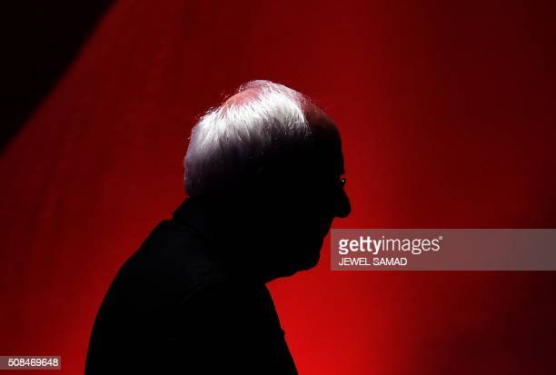 Democratic presidential candidate Bernie Sanders leaves the stage during a break as he participate in the MSNBC Democratic Candidates Debate with...