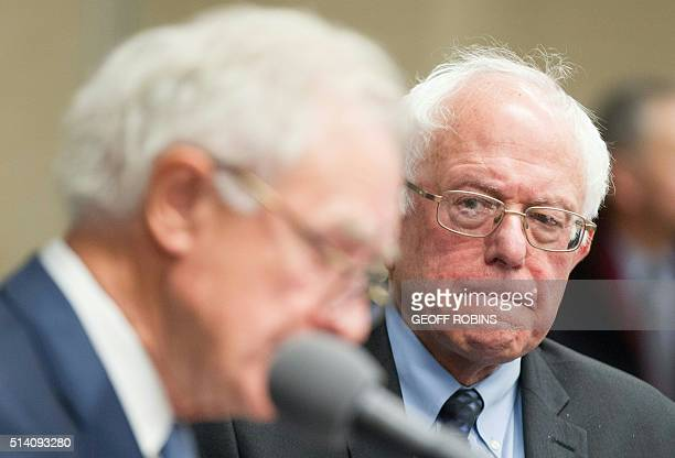 Democratic presidential candidate Bernie Sanders looks on as former senator Don Riegle announces his endorsement of Sanders during a press conference...