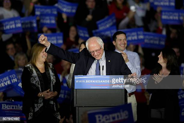 Democratic presidential candidate Bernie Sanders reacts as he speaks at the Holiday Inn February 1 2016 in Des Moines Iowa Sanders was locked in a...