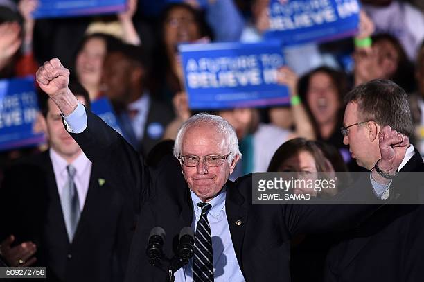 US Democratic presidential candidate Bernie Sanders reacts on stage during a primary night rally in Concord New Hampshire on February 9 2016...