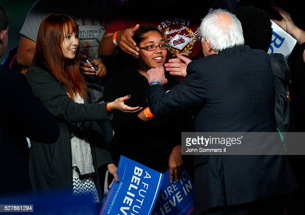Democratic presidential candidate Bernie Sanders shakes hands with campaign supporters after a campaign rally at the Big Four Lawn park May 3 2016 in...