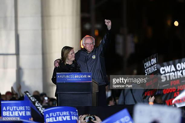 Democratic Presidential candidate Bernie Sanders stands on stage with his wife Jane O'Meara Sanders before speaking to thousands of people at a rally...