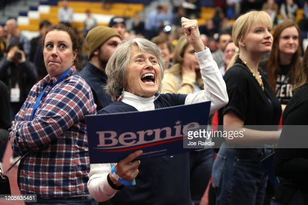 Democratic presidential candidate Bernie Sanders' supporter Lisa Barrett cheers while watching early results at Sanders' New Hampshire primary night...