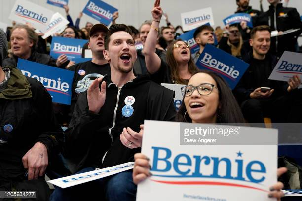 Democratic presidential candidate Bernie Sanders' supporters watch early results come in at Sanders' New Hampshire primary night event on February 11...