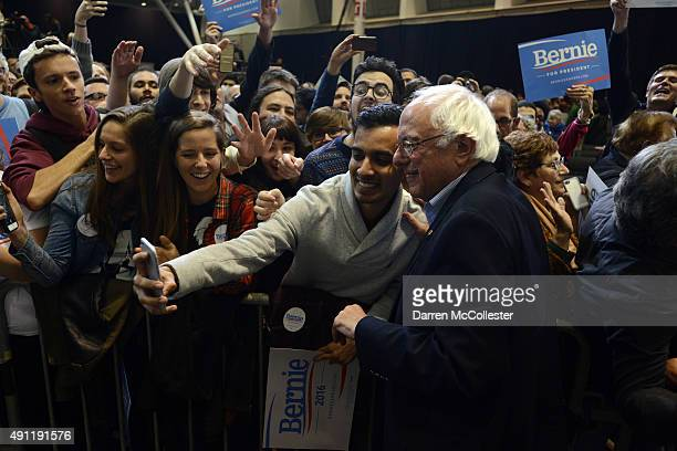 Democratic Presidential candidate Bernie Sanders takes pictures with supporters following a rally at the Boston Convention and Exhibition Center...
