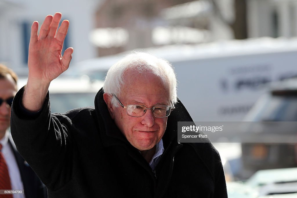 democratic presidential candidate Bernie Sanders walks through downtown Concord on election day on February 9, 2016 in Concord, New Hampshire. Sanders, who is expected to win over Democratic rival Hillary Clinton, greeted voters before taking a short walk where he was mobbed by members of the media.