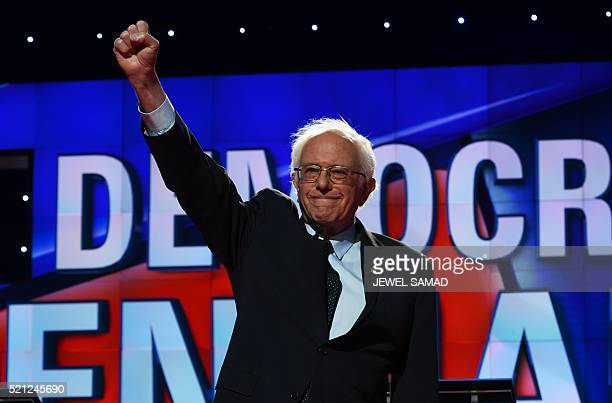 Democratic presidential candidate Bernie Sanders waves as he arrives on stage for the CNN Democratic Presidential Debate at the Brooklyn Navy Yard on...