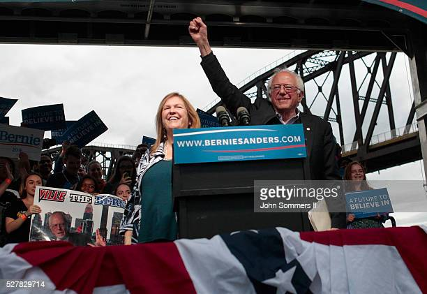 Democratic presidential candidate Bernie Sanders waves to the crowd after arriving at a campaign rally at the Big Four Lawn park May 3 2016 in...