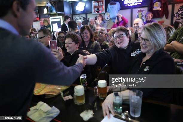 Democratic presidential candidate Beto O'Rourke greets customers and supporters at Yock's Landing during his second day of campaigning for the 2020...