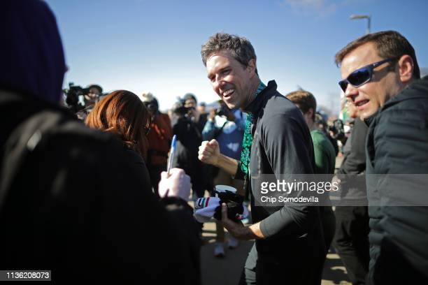 Democratic presidential candidate Beto O'Rourke greets voters after finishing the Lucky Run 5k race March 16 2019 in North Liberty Iowa After losing...