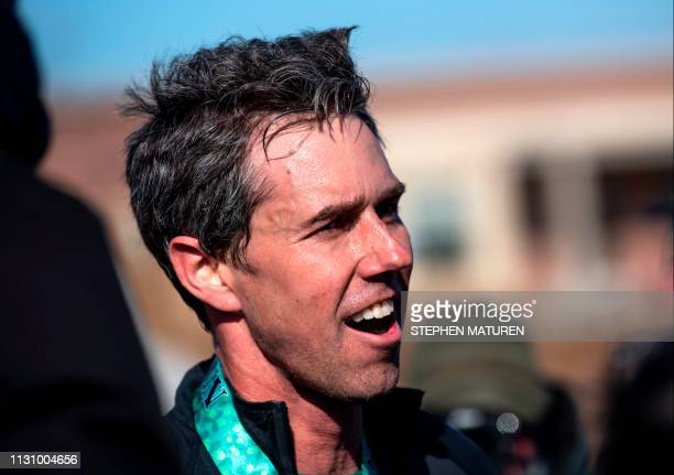 Democratic presidential candidate Beto O'Rourke speaks with media after finishing the Lucky Run 5k race on March 16 2019 in North Liberty Iowa...