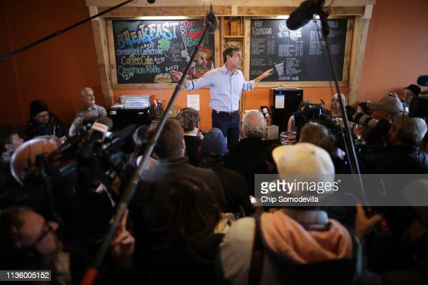 Democratic presidential candidate Beto O'Rourke stands on a counter top as he talks with voters during his second day of campaigning for the 2020...