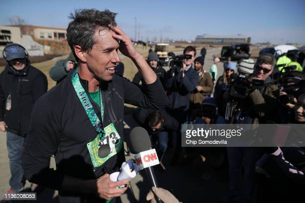 Democratic presidential candidate Beto O'Rourke takes questions from reporters and voters immediately after finishing the Lucky Run 5k race March 16...