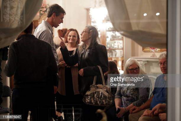 Democratic presidential candidate Beto O'Rourke talks with voters during his first day of campaigning for the 2020 nomination at the home of Randy...