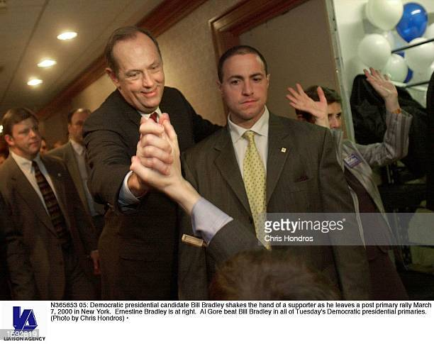 Democratic presidential candidate Bill Bradley shakes the hand of a supporter as he leaves a post primary rally March 7 2000 in New York Ernestine...