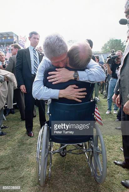 Democratic presidential candidate Bill Clinton hugs a supporter Georgia Secretary of State Max Cleland at a rally Cleland paralyzed during the...
