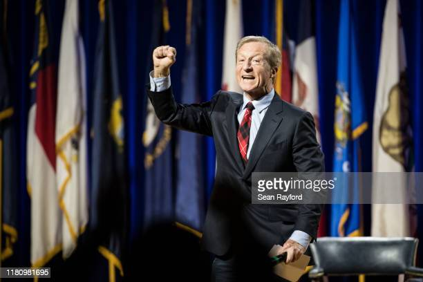 Democratic presidential candidate billionaire Tom Steyer pumps his fist after addressing the audience at the Environmental Justice Presidential...