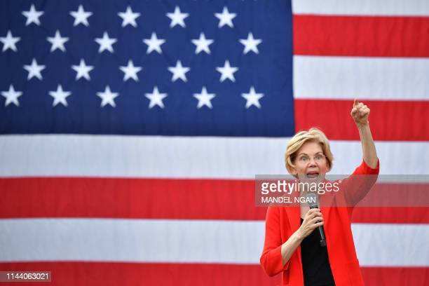 Democratic presidential candidate Elizabeth Warren gestures as she speaks during a campaign stop at George Mason University in Fairfax, Virginia on...