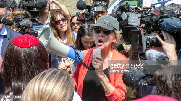 Democratic presidential candidate Elizabeth Warren is swarmed by the press while visiting at the Homestead Detention Center ahead of the first...