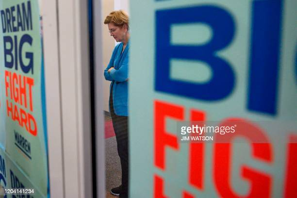 Democratic presidential candidate Elizabeth Warren waits backstage as she prepares to speak at a Get Out the Vote rally in Columbia South Carolina on...