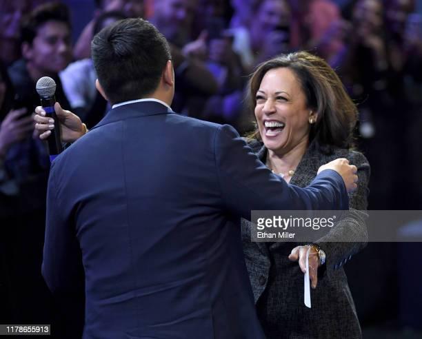 Democratic presidential candidate, entrepreneur Andrew Yang hugs fellow candidate, U.S. Sen. Kamala Harris after Yang spoke and before Harris was...