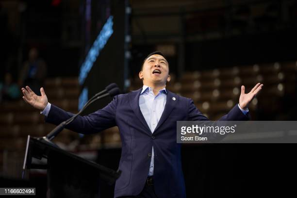 Democratic presidential candidate, entrepreneur Andrew Yang reacts as he goes on stage during the New Hampshire Democratic Party Convention at the...