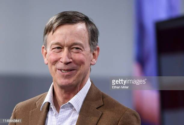 Democratic presidential candidate former Colorado Gov John Hickenlooper smiles as he is introduced at the National Forum on Wages and Working People...
