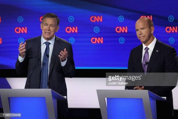 Democratic presidential candidate former Colorado governor John Hickenlooper speaks while former Maryland congressman John Delaney listens during the...