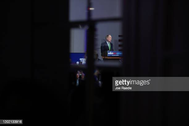 """Democratic presidential candidate former New York City Mayor Mike Bloomberg is seen in a mirror as he speaks during a """"United for Mike"""" event held at..."""