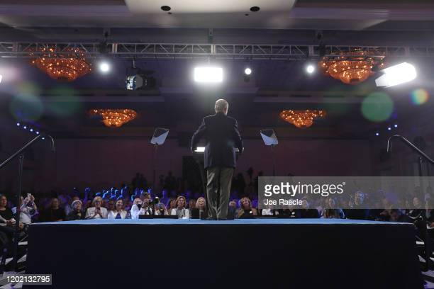 "Democratic presidential candidate former New York City Mayor Mike Bloomberg speaks during a ""United for Mike"" event held at the Aventura Turnberry..."