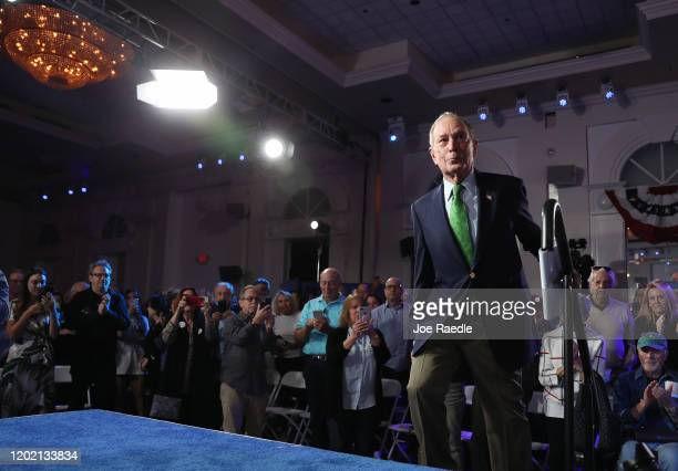 """Democratic presidential candidate former New York City Mayor Mike Bloomberg arrives on stage to speak during a """"United for Mike"""" event held at the..."""