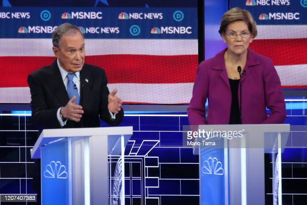 Democratic presidential candidate former New York City Mayor Mike Bloomberg speaks as Sen Elizabeth Warren listens during the Democratic presidential...