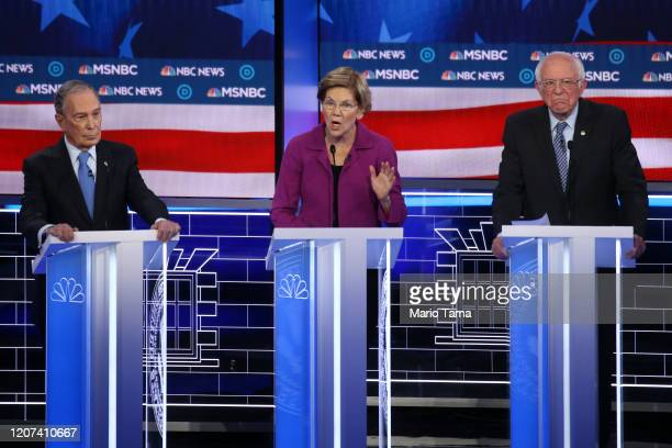 Democratic presidential candidate former New York City Mayor Mike Bloomberg and Sen Bernie Sanders listen as Sen Elizabeth Warren speaks during the...
