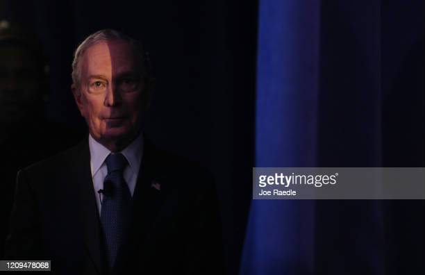 Democratic presidential candidate former New York City mayor Mike Bloomberg waits behind a curtain to be introduced to speak during a rally held at...