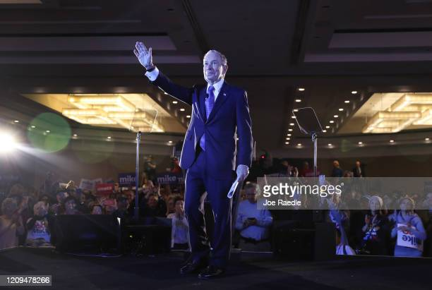 Democratic presidential candidate former New York City mayor Mike Bloomberg waves to the crowd during a campaign rally held at the Hilton McLean...