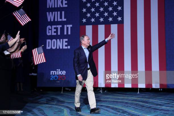 Democratic presidential candidate former New York City Mayor Mike Bloomberg walks out before speaking at his Super Tuesday night event on March 03,...