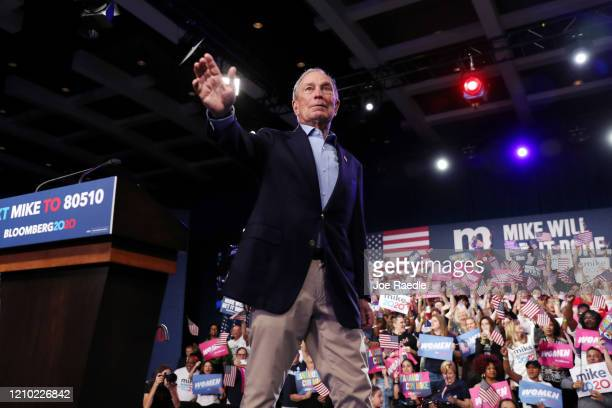 Democratic presidential candidate former New York City mayor Mike Bloomberg waves to his supporters at his Super Tuesday night event on March 03,...