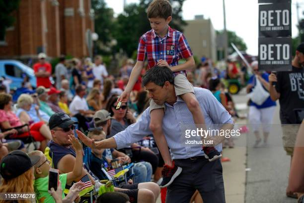 Democratic presidential candidate, former Rep. Beto O'Rourke and his son Henry O'Rourke greet people during the Fourth of July parade on July 4, 2019...
