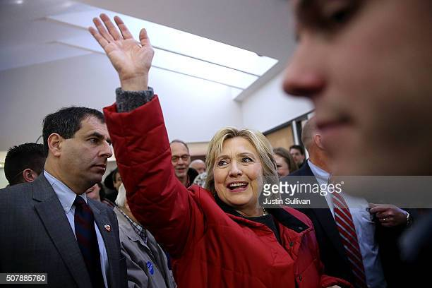 Democratic presidential candidate former Secretary of State Hillary Clinton waves to supporters as she visits volunteers at a campaign office on...