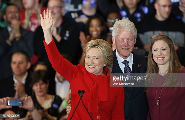 Democratic presidential candidate former Secretary of State Hillary Clinton waves to supporters as Former US president Bill Clinton and daughter...