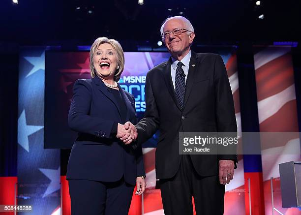 Democratic presidential candidate former Secretary of State Hillary Clinton and US Sen Bernie Sanders shake hands at the start of their MSNBC...