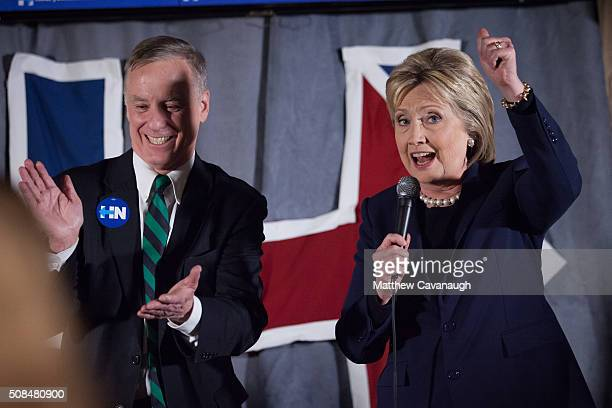 Democratic presidential candidate former Secretary of State Hillary Clinton and former Vermont Gov Howard Dean speak to supporters at a debate...