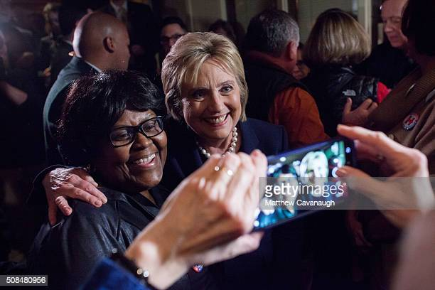 Democratic presidential candidate former Secretary of State Hillary Clinton poses for a photo with supporter Juanita Cherry of Washington DC at a...
